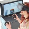 Femme entrain de visualiser en réalité virtuelle une maison avec un casque Oculus Rift